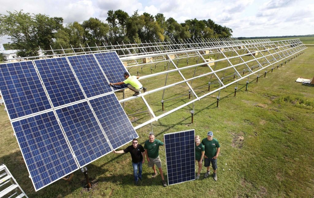 Solar panels being installed on a farm